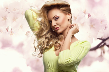 Beautiful smiling blonde woman with spring flowers