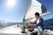 Man sailing with sails out on a sunny day - 63916809