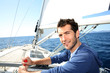 Man sailing with sails out on a sunny day - 63916855