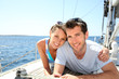 Couple relaxing on sailboat deck