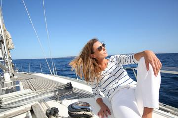 Attractive modern woman enjoying sailing cruise