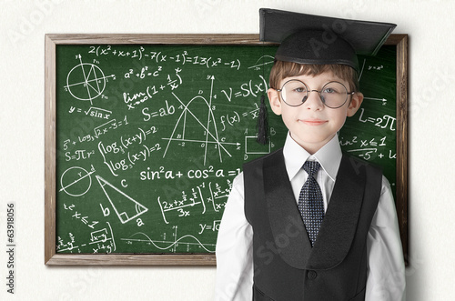 boy near blackboard with formulas