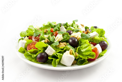 Salat with cheese on white background
