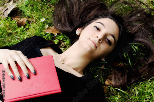 young girl in relax with a book in her hand
