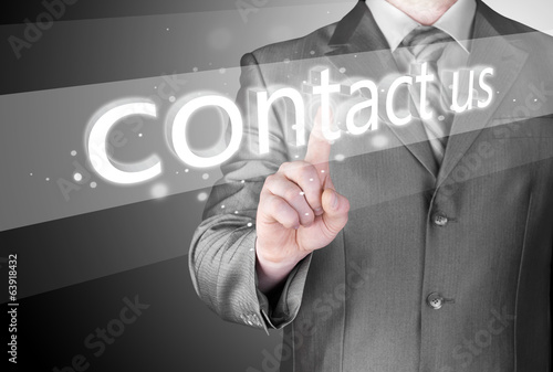 Businessman pushing CONTACT US sign
