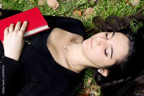 young girl asleep after a good reading