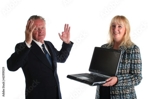 Senior businessman in disagreement with his assistant.