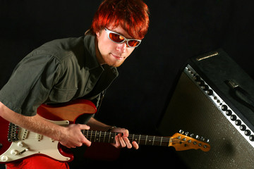 Guitarist with his guitar