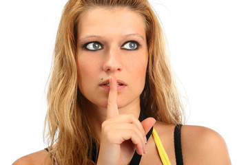 Blonde woman holding her finger to her lips