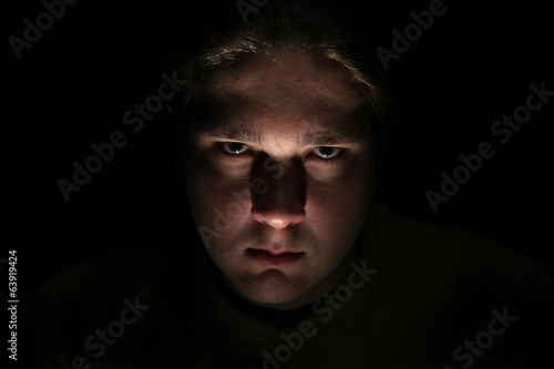Dark evil face on black background