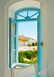 coloured window of an old house in Amorgos island in Greece