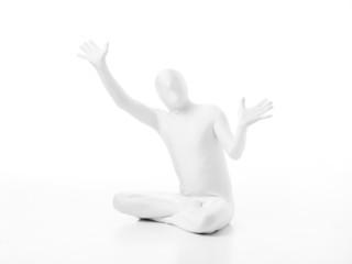 faceless man sitting on the floor