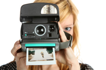 Girl with old point and shoot instant camera