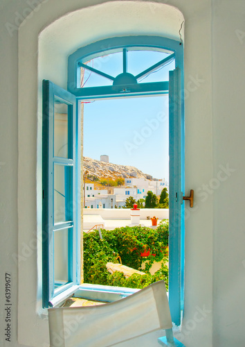 coloured window of an old house in Amorgos island in Greece - 63919677