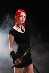 Beautiful red hair girl with katana sword