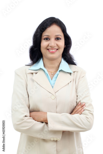 Young business woman with arms crossed against white