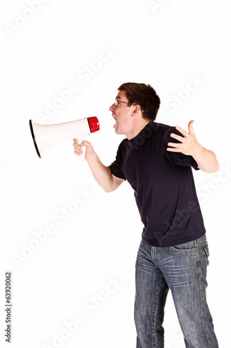 Young man screaming with megaphone