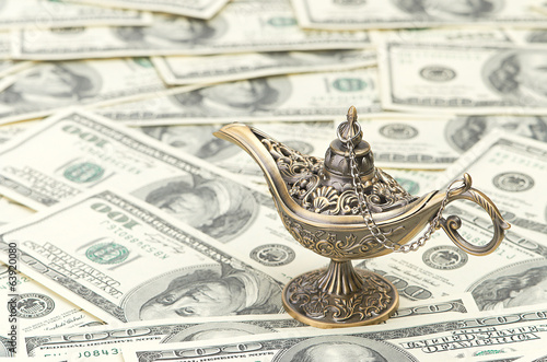 aladdin lamp on dollar background