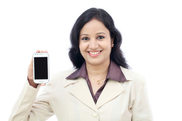 Young business woman showing mobile phone