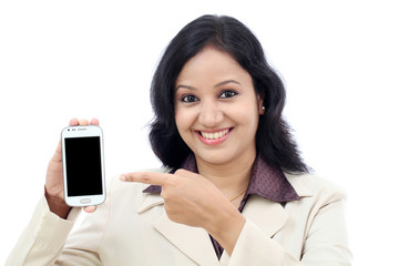 Young business woman showing black display of mobile phone