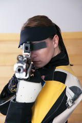 Young Woman Shooting Target