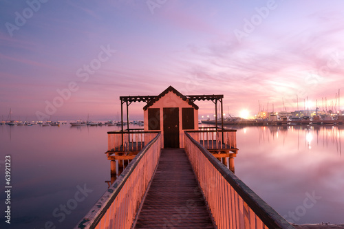 Beach cabin on San Pedro del Pinatar coast, Spain at sunset