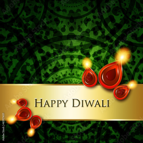 oil lamps with diwali greetings over green  background