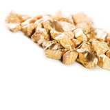 Gold nuggets on white background.