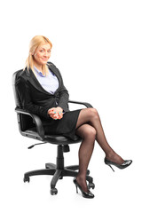 Blond businesswoman sitting in an office chair