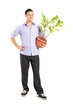 Young man holding a plant