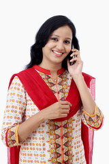 Smiling young woman talking on cell phone