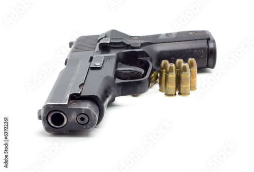 pistol with ammo on white background