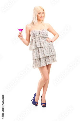 Young woman holding a pink cocktail