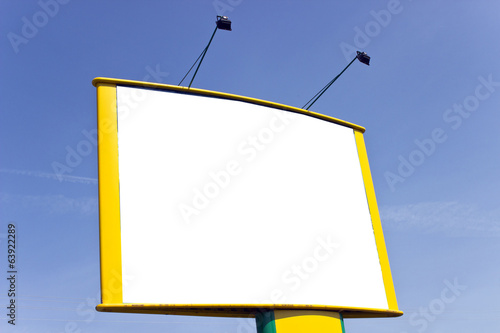 Blank yellow billboard over blue sky