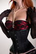 Busty redhead woman wearing corset, vintage red bra and sheer gl