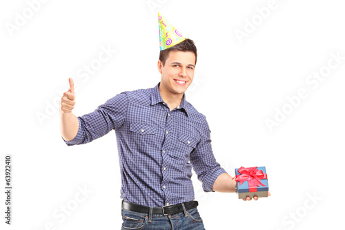 Man holding a present and giving thumb up