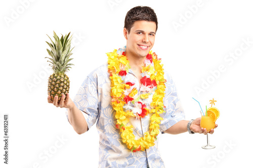 Man holding a pineapple and cocktail