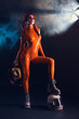 Sexy girl in orange latex catsuit with helmet, sci-fi theme