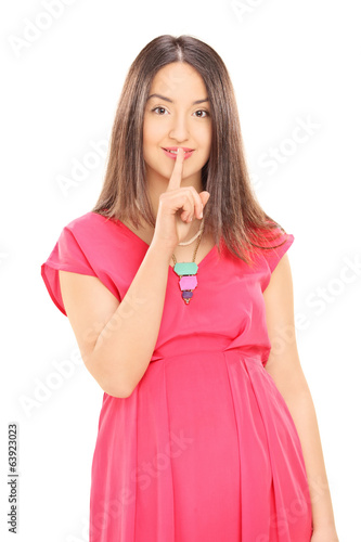 Woman holding finger on lips