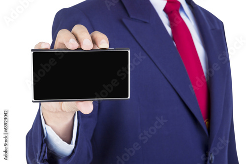 smartphone on businessman hand