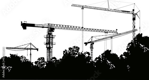 four tower cranes and trees isolated on white