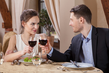 Couple drinking vine