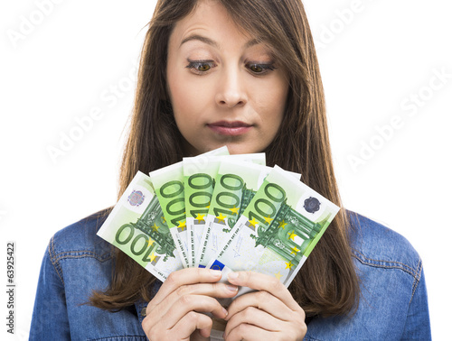 Beauitful woman holding some Euro currency notes