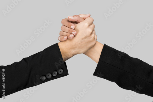 Greeting hands over a gray background