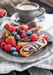 Chocolate eclairs with fresh berries