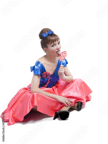 Girl dressed and maked up in retro style with candy