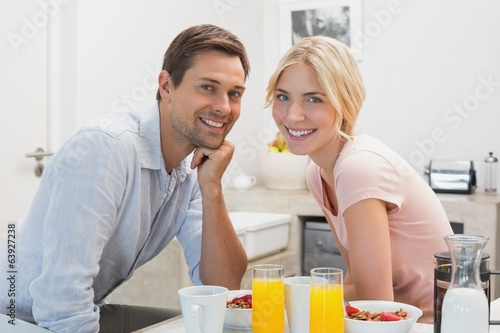 Young couple having breakfast at home