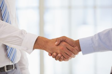 Close-up shot of a handshake in office