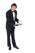 Confident waiter showing empty tray over white background