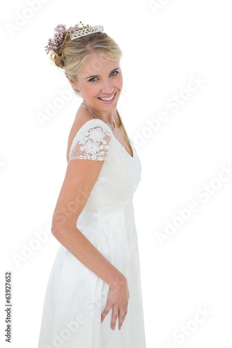 Portrait of happy bride standing against white background